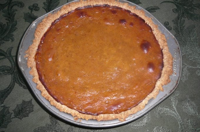 butternut squash pie in a pan on a table