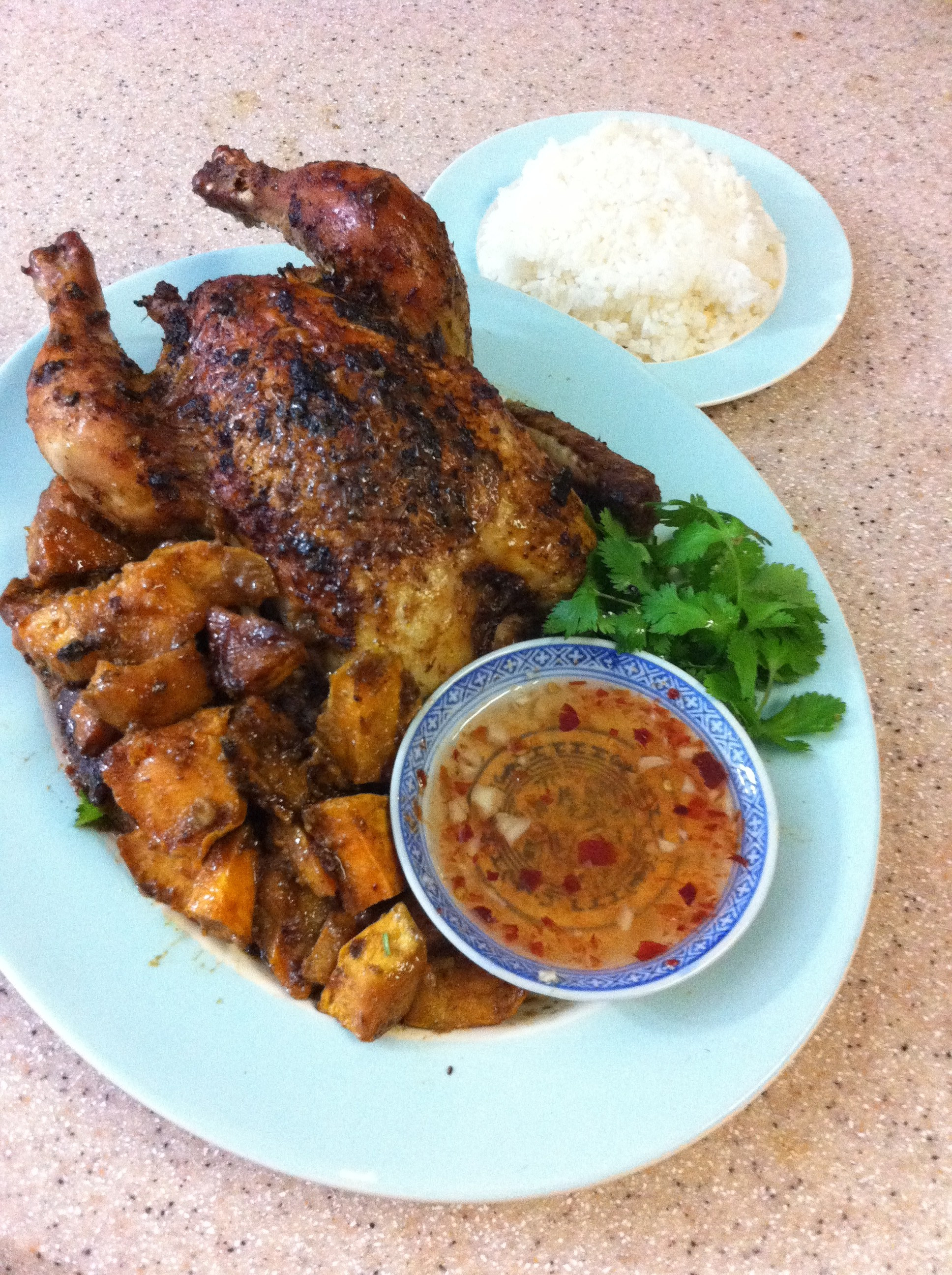 Dinner's ready! Roast chicken with Thai flavors, served with pan-roasted sweet potatoes, sweet hot garlic sauce and jasmine rice.