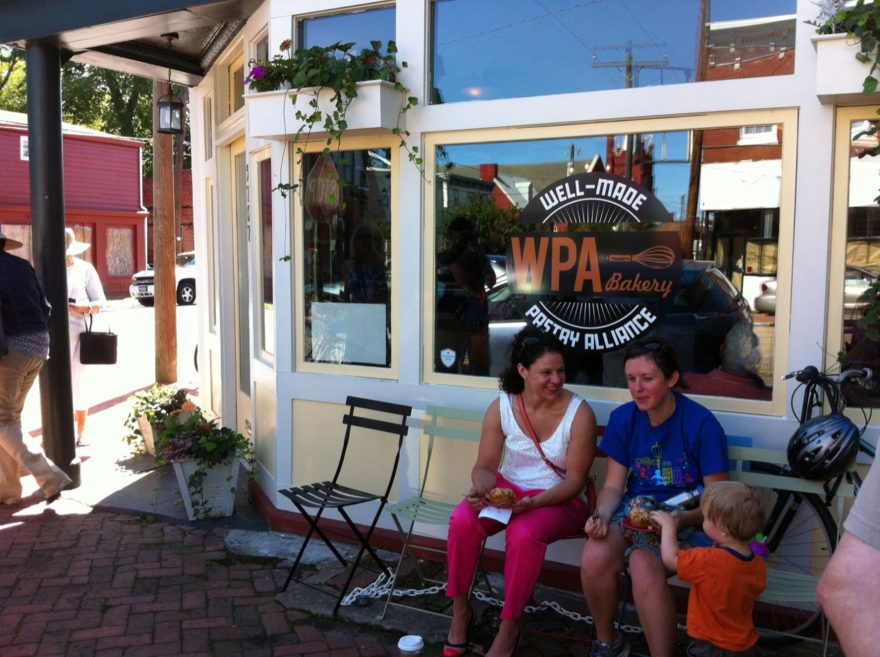 Customers wait for a table in seats outside WPA Bakery Richmond VA in Saturday morning sunshine