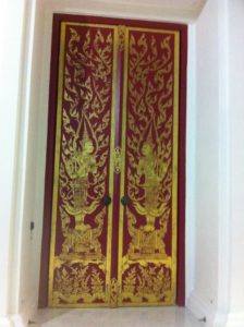 A gorgeous Thai door adorned with traditional Thai painting.
