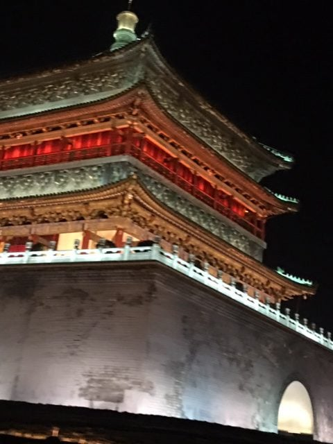 The Bell Tower glowing at night. We loved viewing it from our taxi, lit up in orange, gold, moss green, and white, glows majestically against the night sky.