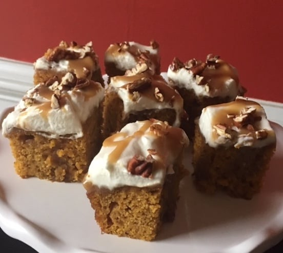 Pumpkin Poke Cake With Whipped Cream, Pecans, And Caramel