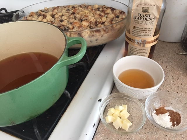 Pudding in the background, with ingredients for sauce ready to combine: Brown sugar, bourbon, butter,