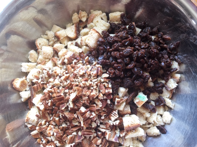Pecans, raisins and all the small bits of stale bread, ready to become bread pudding,.