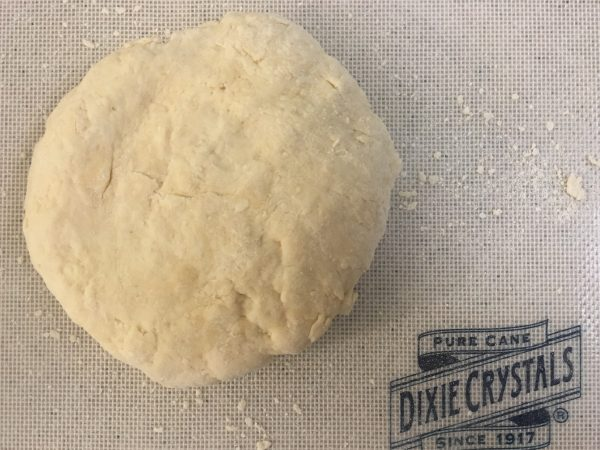 Dough for my roly poly, shaped and ready to go, on a silpat mat from Dixie Crystals. It's flour, sugar , butter, salt and water, patted into a biscuit dough. What nextw???