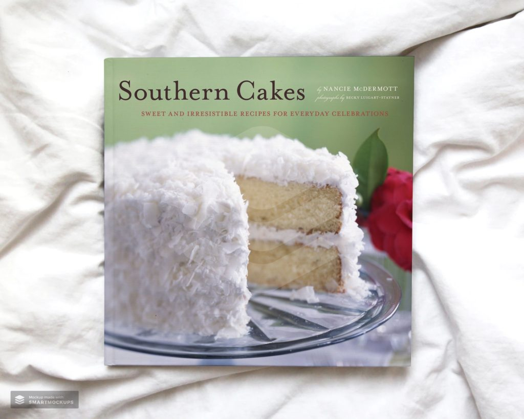 Southern Cakes Book by Nancie Mcdermott laying on a white blanket