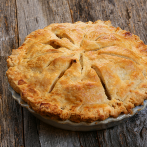 Apple Pie in a pan on a wood surface